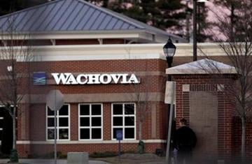 Police watch a Wachovia Bank in Cary, N.C., where an armed man took four people hostage Thursday, Feb. 10, 2011. Television footage shows the subject was shot as he exited the bank with a hostage. (AP Photo/Gerry Broome) By Gerry Broome