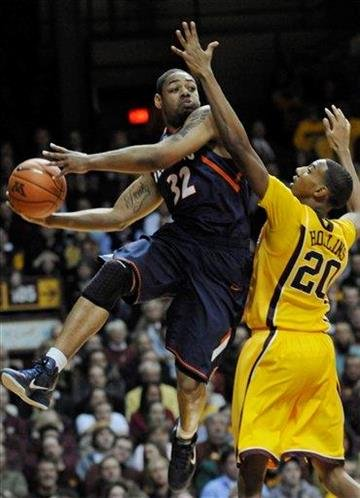 Minnesota's Austin Hollins, right, defends as Illinois' Demetri McCamey looks to pass during the first half of an NCAA college basketball game Thursday, Feb. 10, 2011, in Minneapolis. (AP Photo/Jim Mone) By Jim Mone