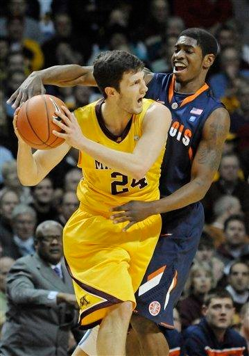 Minnesota's Blake Hoffarber looks for assistance as Illinois' Brandon Paul defends during the first half of an NCAA college basketball game Thursday, Feb. 10, 2011, in Minneapolis. (AP Photo/Jim Mone) By Jim Mone