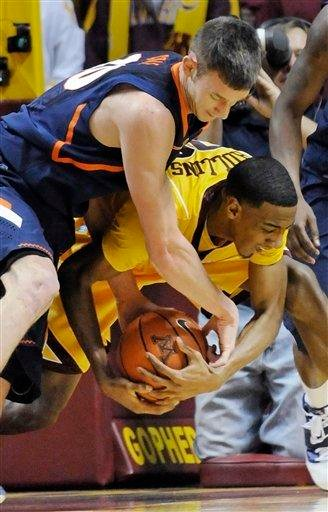 Minnesota's Austin Hollins, right, and Illinois' Bill Cole battle for the ball during the first half of an NCAA college basketball game Thursday, Feb. 10, 2011, in Minneapolis. (AP Photo/Jim Mone) By Jim Mone