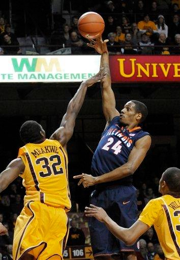 Illinois' Mike Davis, right, shoots over Minnesota's Trevor Mbakwe during the first half of an NCAA college basketball game Thursday, Feb. 10, 2011, in Minneapolis. (AP Photo/Jim Mone) By Jim Mone