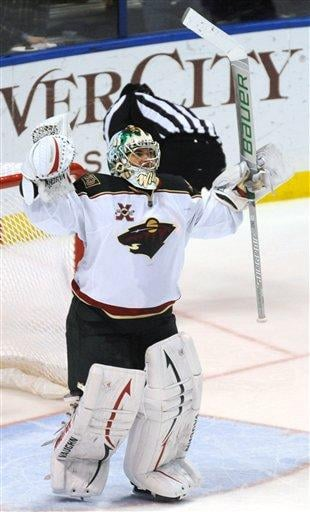Minnesota Wild's goalie Jose Theodore celebrates a win over the St. Louis Blues in a shootout of an NHL hockey game Friday, Feb. 11, 2011, in St. Louis. (AP Photo/Bill Boyce) By Bill Boyce