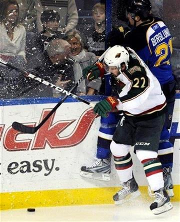 Minnesota Wild's Cal Clutterbuck (22) and St. Louis Blues' Patrik Berglund (21), of Sweden, collide on the boards in the second period of an NHL hockey game Friday, Feb. 11, 2011, in St. Louis. (AP Photo/Bill Boyce) By Bill Boyce