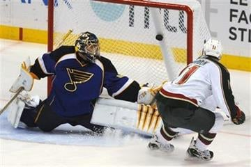 Minnesota Wild's John Madden (11) scores the game-winning shootout goal on St. Louis Blues goalie Jaroslav Halak, left, of Slovakia, in an NHL hockey game Friday, Feb. 11, 2011, in St. Louis. (AP Photo/Bill Boyce) By Bill Boyce