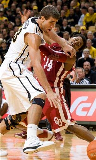 Missouri's Justin Safford, left, fouls Oklahoma's Carl Blair, right, as they battle for a loose ball during the first half of an NCAA college basketball game Saturday, Feb. 12, 2010, in Columbia, Mo. (AP Photo/L.G. Patterson) By L.G. Patterson