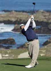 Steve Marino hits from the 13th tee of the Monterey Peninsula Country Club during the third round of the AT&T Pebble Beach National Pro-Am golf tournament in Pebble Beach, Calif., Saturday, Feb. 12, 2011. (AP Photo/Eric Risberg) By Eric Risberg
