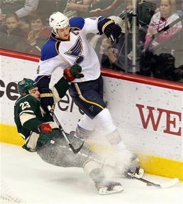 Minnesota Wild's Eric Nystrom, left, falls to the ice as he battles for possession against St. Louis Blues' Eric Brewer during the third period of an NHL hockey game Saturday, Feb. 12, 2011, in St. Paul, Minn. (AP Photo/Genevieve Ross) By Genevieve Ross