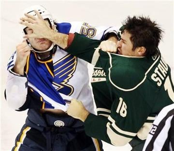 Minnesota Wild's Brad Staubitz, right, fights St. Louis Blues' Cam Janssen, left, during the first period of an NHL hockey game Saturday, Feb. 12, 2011, in St. Paul, Minn. (AP Photo/Genevieve Ross) By Genevieve Ross