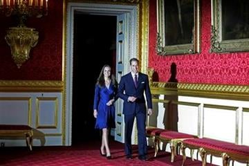 Britain's Prince William and his fiancee Kate Middleton  walk into the room for a photo-call  at St. James's Palace in London, Tuesday Nov. 16, 2010, after they announced their engagement. The couple are to wed in 2011. (AP Photo/Sang Tan) By Sang Tan