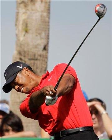 Tiger Woods from U.S. tees off on the 9th hole during the final round of the Dubai Desert Classic golf tournament at the Emirates Golf Club in Dubai, United Arab Emirates, Sunday Feb. 13, 2011. (AP Photo/Kamran Jebreili) By Kamran Jebreili