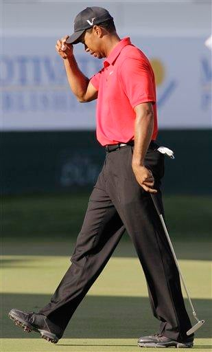 Tiger Woods from U.S. reacts after he finishes on the 18th hole during the final round of Dubai Desert Classic golf tournament at the Emirates Golf Club in Dubai, United Arab Emirates, Sunday Feb. 13, 2011. (AP Photo/Kamran Jebreili) By Kamran Jebreili