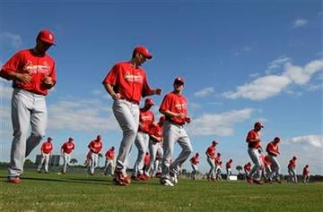 Members of the St. Louis Cardinals warm up during spring training baseball Monday, Feb. 14, 2011, in Jupiter, Fla. (AP Photo/Jeff Roberson) By Jeff Roberson
