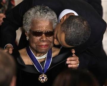 President Barack Obama kisses author and poet Maya Angelou after awarding her the 2010 Medal of Freedom during a ceremony in the East Room of the White House in Washington Tuesday, Feb. 15, 2011. (AP Photo/Charles Dharapak) By Charles Dharapak