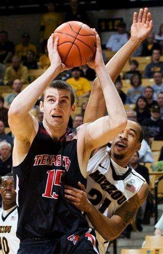 Texas Tech's Robert Lewandowski, left, shoots past Missouri's Laurence Bowers, right, during the first half of an NCAA college basketball game, Tuesday, Feb. 15, 2011, in Columbia, Mo. (AP Photo/L.G. Patterson) By L.G. Patterson