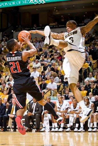 Missouri's Matt Pressey, right, tries to block the shot of Texas Tech's John Roberson, left, during the first half of an NCAA college basketball game, Tuesday, Feb. 15, 2011, in Columbia, Mo. (AP Photo/L.G. Patterson) By L.G. Patterson