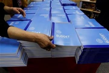 Copies of the U.S. Government budget for Fiscal Year 2012 are stacked up at the U.S. Government Printing Office in Washington, Monday, Feb. 14, 2011.(AP Photo/Alex Brandon) By Alex Brandon