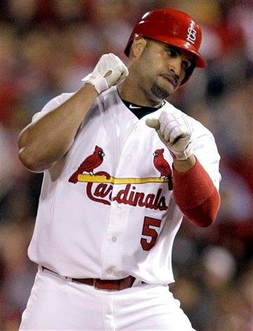 St. Louis Cardinals' Albert Pujols celebrates after hitting an RBI-single during the second inning of a baseball game against the San Diego Padres, Friday, Sept. 17, 2010, in St. Louis. (AP Photo/Jeff Roberson) By Jeff Roberson