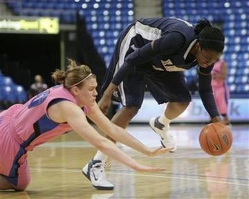 Saint Louis' Mallory Eggert, left, and Xavier's Amber Harris reach for the ball during the first half of an NCAA college basketball game Wednesday, Feb. 16, 2011, in St. Louis. (AP Photo/Jerry Naunheim) By Jerry Naunheim