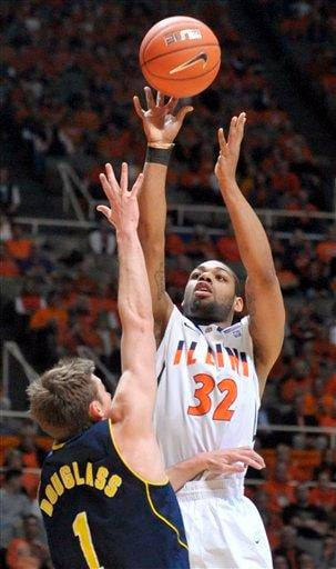 Illinois guard Demetri McCamey (32) shoots over Michigan guard Stu Douglass (1) during an NCAA college basketball game at Assembly Hall in Champaign, Ill., on Wednesday, Feb. 16, 2011. (AP Photo/Robin Scholz) By Robin Scholz