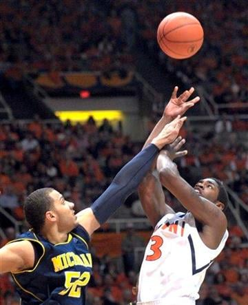 Illinois guard Brandon Paul (3) shoots over Michigan forward Jordan Morgan (52) during an NCAA college basketball game at Assembly Hall in Champaign, Ill., on Wednesday, Feb. 16, 2011. (AP Photo/Robin Scholz) By Robin Scholz