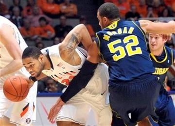 Illinois guard Demetri McCamey (32) drives past Michigan forward Jordan Morgan (52) during an NCAA college basketball at Assembly Hall in Champaign, Ill., on Wednesday, Feb. 16, 2011. (AP Photo/Robin Scholz) By Robin Scholz
