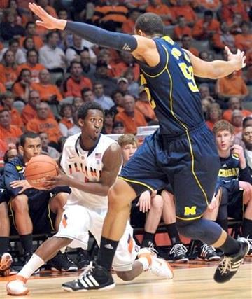 Illinois' guard D.J. Richardson (1) looks to pass past Michigan's forward Jordan Morgan (52) during an NCAA College basketball game at Assembly Hall in Champaign, Ill., on Wednesday, Feb. 16, 2011. (AP Photo/Robin Scholz) By Robin Scholz