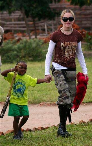 FILE - In this March 30, 2009 file photo, U.S. singer Madonna with adopted son David Banda visiting the Mphandula Day Care Centre for orphans near Lilongwe, Malawi. (AP Photo/Tsvangirayi Mukwazhi, file) By TSVANGIRAYI MUKWAZHI
