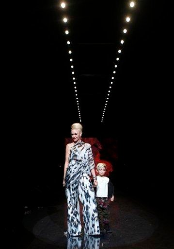 Designer Gwen Stefani walks the runway with her Kingston after the L.A.M.B. fall 2011 collection show during Fashion Week Thursday, Feb. 17, 2011 in New York. (AP Photo/Jason DeCrow) By Jason DeCrow