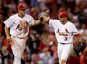 St. Louis Cardinals third baseman David Freese and shortstop Felipe Lopez celebrate after the Cardinals 9-5 victory over the Los Angeles Angels in a baseball game Friday, May 21, 2010, in St. Louis. (AP Photo/Jeff Roberson) By Jeff Roberson