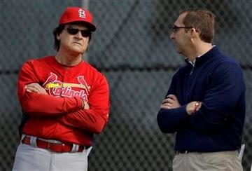St. Louis Cardinals manager Tony La Russa, left, talks with general manager John Mozeliak during spring training baseball Monday, Feb. 14, 2011, in Jupiter, Fla. (AP Photo/Jeff Roberson) By Jeff Roberson
