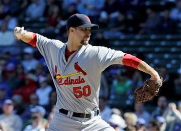 St. Louis Cardinals starting pitcher Adam Wainwright delivers during the first inning of a baseball game against the Chicago Cubs, Friday, Sept. 24, 2010, at Wrigley Field in Chicago. (AP Photo/Charles Rex Arbogast) By Charles Rex Arbogast