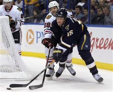 Chicago Blackhawks' Jake Dowell (28) tries to stop St. Louis Blues' Brad Winchester (15) from centering the puck in the second period of an NHL hockey game Monday, Feb. 21, 2011, in St. Louis. (AP Photo/Tom Gannam) By Tom Gannam