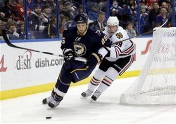 St. Louis Blues' Chris Stewart (25) beats Chicago Blackhawks' Jonathan Toews (19) to the lose puck in the first period of an NHL hockey game, Monday, Feb. 21, 2011 in St. Louis.(AP Photo/Tom Gannam) By Tom Gannam