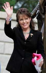 Former Alaska Gov. Sarah Palin waves to supporters after endorsing S.C. gubernatorial candidate Nikki Haley, during a campaign rally at The Statehouse, Friday, May, 14, 2010, in Columbia, S.C. (AP Photo/Mary Ann Chastain) By Mary Ann Chastain