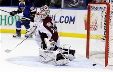 Colorado Avalanche goalie Peter Budaj (31) makes a kick save in the second period of an NHL hockey game against the St. Louis Blues, Tuesday, Feb. 22, 2011, in St. Louis. (AP Photo/Tom Gannam) By Tom Gannam