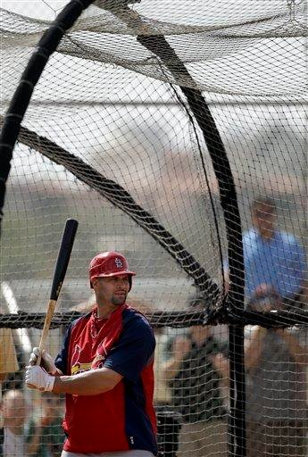 St. Louis Cardinals' Albert Pujols takes batting practice during baseball spring training on Sunday, Feb. 20, 2011, in Jupiter, Fla. (AP Photo/Jeff Roberson) By Jeff Roberson