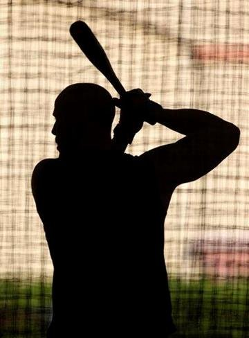St. Louis Cardinals' Matt Holliday works in the batting cage during spring training baseball Sunday, Feb. 20, 2011, in Jupiter, Fla. (AP Photo/Jeff Roberson) By Jeff Roberson