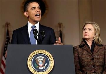President Barack Obama, left, speaks about the situation in Libya with Secretary of State Hillary Rodham Clinton in the Grand Foyer of the White House, Wednesday, Feb. 23, 2011, in Washington. (AP Photo/Carolyn Kaster) By Carolyn Kaster