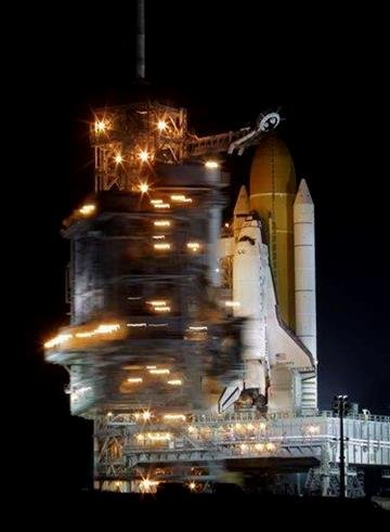 Space shuttle Discovery stands ready for launch at Pad 39A as the rotating service structure is moved back to expose the orbiter at the Kennedy Space Center in Cape Canaveral, Fla., Wednesday, Feb. 23, 2011. (AP Photo/John Raoux) By John Raoux
