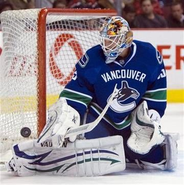 Vancouver Canucks goalie Cory Schneider makes a save against the St. Louis Blues during the first period of an NHL hockey game Thursday, Feb. 24, 2011, in Vancouver, British Columbia. (AP Photo/The Canadian Press, Jonathan Hayward) By Jonathan Hayward