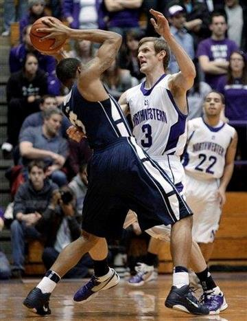Northwestern's Mike Capocci, right, guards Penn State's Jermaine Marshall during the first half of an NCAA college basketball game in Evanston, Ill., Thursday, Feb. 24, 2011. (AP Photo/Nam Y. Huh) By Nam Y. Huh