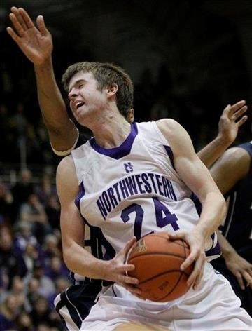 Northwestern's John Shurna, front, works against Penn State's Jeff Brooks, obscured, during the second half of an NCAA college basketball game in Evanston, Ill., Thursday, Feb. 24, 2011. Penn State won 66-52. (AP Photo/Nam Y. Huh) By Nam Y. Huh