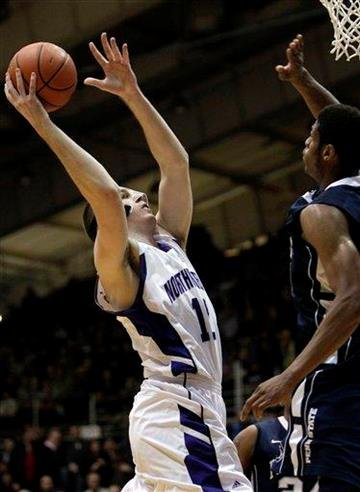 Northwestern's Luka Mirkovic, left, shoots over Penn State's Jeff Brooks during the first half of an NCAA college basketball game in Evanston, Ill., Thursday, Feb. 24, 2011. (AP Photo/Nam Y. Huh) By Nam Y. Huh