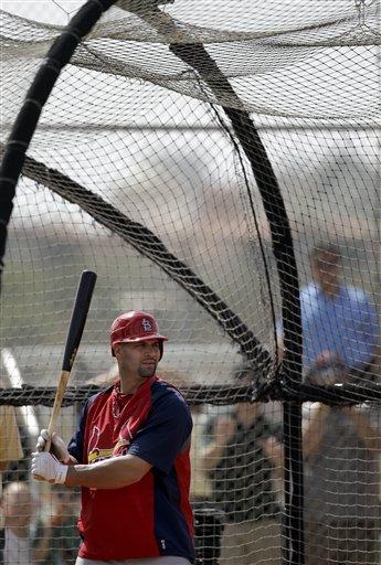 St. Louis Cardinals' Albert Pujols takes batting practice during baseball spring training on Sunday, Feb. 20, 2011, in Jupiter, Fla. (AP Photo/Jeff Roberson) By Jeff Roberson
