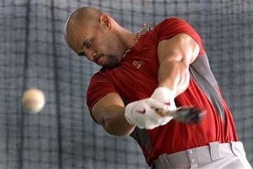 St. Louis Cardinals' Albert Pujols takes a swing in a batting cage during spring training baseball Sunday, Feb. 20, 2011, in Jupiter, Fla. (AP Photo/Jeff Roberson) By Jeff Roberson