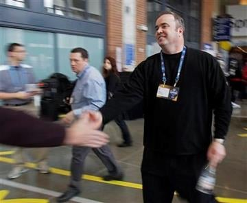 Green Bay Packers head coach Mike McCarthy walks to a news conference during the NFL football scouting combine in Indianapolis, Friday, Feb. 25, 2011. (AP Photo/Darron Cummings) By Darron Cummings