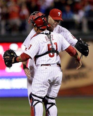 Philadelphia Phillies' Carlos Ruiz (51) and Ryan Madson celebrate after beating the St. Louis Cardinals 9-2 in a baseball game to clinch the NL East title, Saturday, Sept. 17, 2011, in Philadelphia. (AP Photo/Matt Slocum) By Matt Slocum