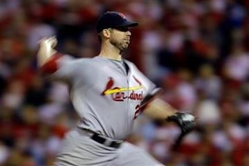 In this image taken with slow shutter speed, St. Louis Cardinals' Chris Carpenter pitches in the third inning of a baseball game against the Philadelphia Phillies, Sunday, Sept. 18, 2011, in Philadelphia. (AP Photo/Matt Slocum) By Matt Slocum