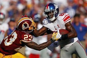 Washington Redskins defensive back DeAngelo Hall reaches for New York Giants wide receiver Hakeem Nicks during the first half of an NFL football game in Landover, Md., on Sunday, Sept. 11, 2011.  (AP Photo/Evan Vucci) By Evan Vucci