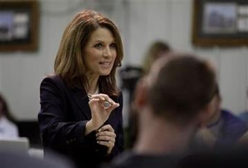 Republican presidential hopeful Rep. Michele Bachmann, R-Minn., speaks to employees during a plant tour at Sukup Manufacturing, Monday, Sept. 19, 2011, in Sheffield. (AP Photo/Charlie Neibergall) By Charlie Neibergall